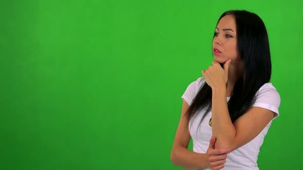Thumbnail for Young Pretty Woman Thinks About Something - Green Screen - Studio