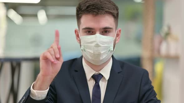 Thumbnail for Young Businessman with Protective Face Mask Showing No Sign