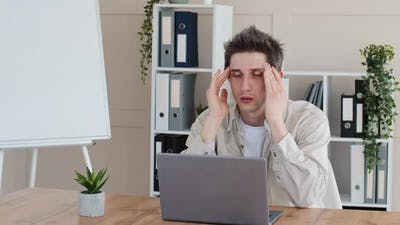 Tired Exhausted Overworked Caucasian Guy Business Man Freelancer Feeling Tension Headache Massaging