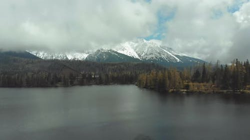 Aerial View of Strbske Pleso in the Clouds and Snowy Mountains, Slovakia
