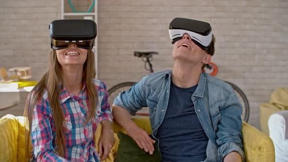 Thumbnail for Young Man and Woman Enjoying Virtual Reality