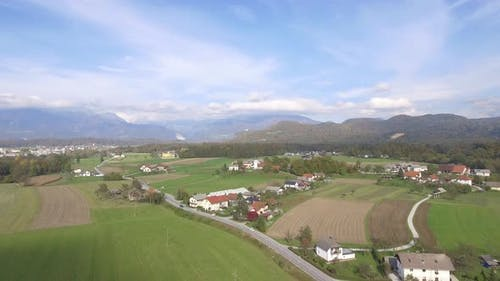 Village In Slovenia With Julian Alps In The Background