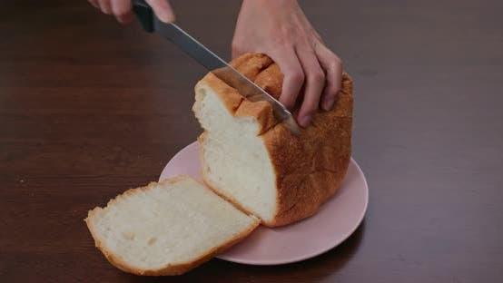 Thumbnail for Schneiden Sie ein Stück Weißbrot