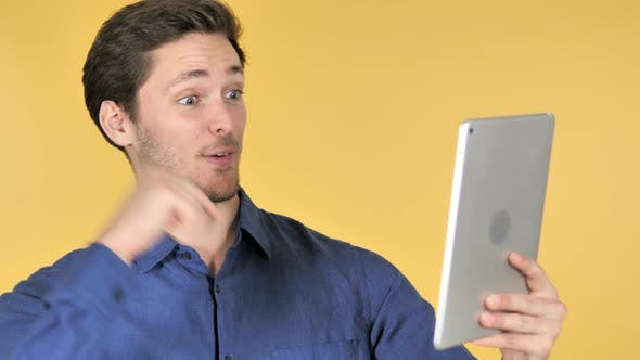 Thumbnail for Online Video Chat via Tablet on Yellow Background