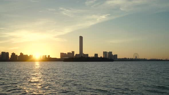 Thumbnail for Sonnenaufgang mit CBD-Gebäuden, in Suzhou, China