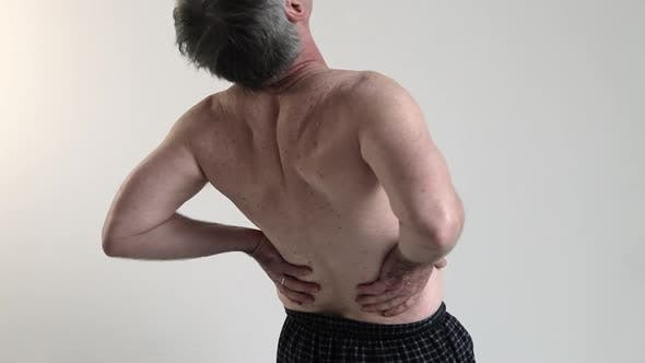 Thumbnail for Man experiencing back pain