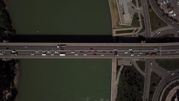 Drone's Eye View -  Aerial Car Driving on a Car Bridge.