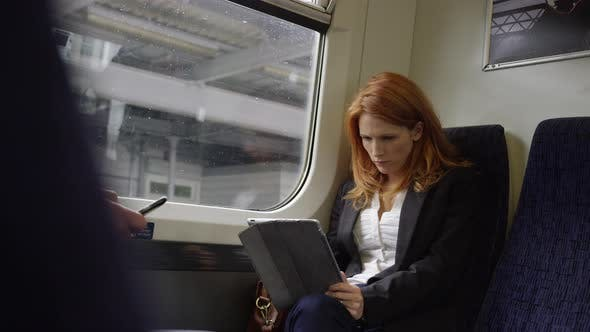 Commuters on the their way to work using technology
