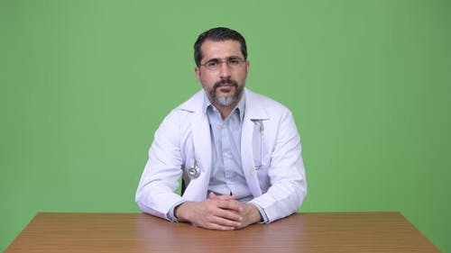 Handsome Persian Bearded Man Doctor Smiling