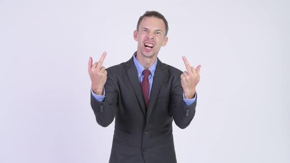 Thumbnail for Studio Shot von wütend Geschäftsmann zeigt Mittelfinger