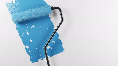 A Paint Roller with a Chrome Handle Rolls Blue Paint Onto a White Wall