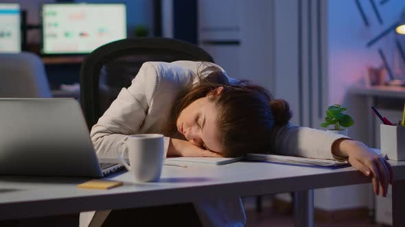 Exhausted Overload Business Woman Falling Asleep on Desk