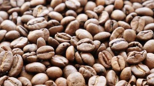 Shallow DOF tilting on roasted coffee beans  arranged on table 4K 3840X2160 30fps UltraHD footage -