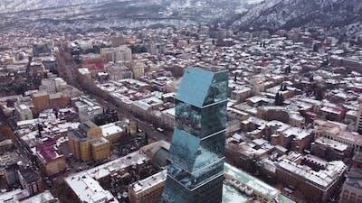Glass skyscraper in the snowy city