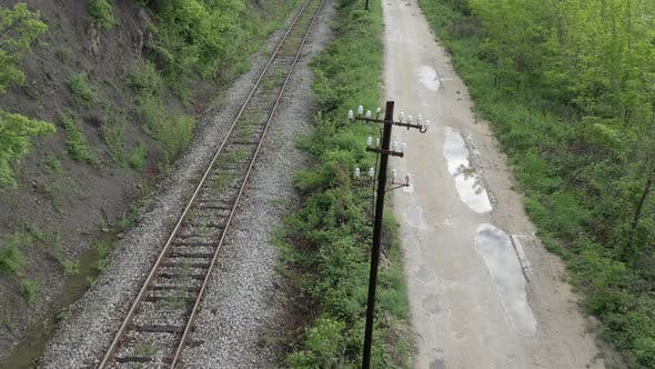 Thumbnail for Flying over the railroad tracks and dirt road 4K drone video