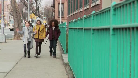 Thumbnail for Three girls walking together