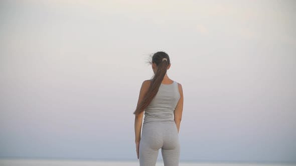 Cover Image for Girl Doing Exercise Against Sea Background