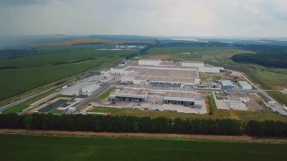 Thumbnail for Aerial View of Warehouse With Trucks