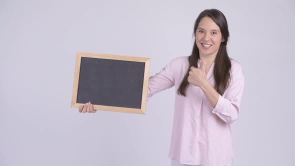 Young Happy Businesswoman Holding Blackboard and Giving Thumbs Up