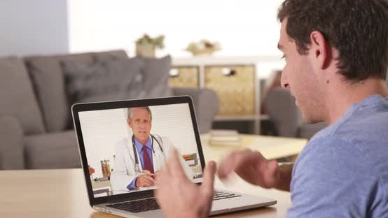 Guy using laptop to talk to doctor