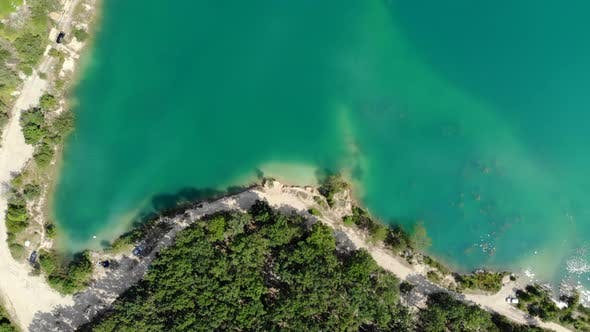 Aerial View of a Blue Lake Surrounded By Forest