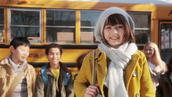 Thumbnail for Girl by school bus