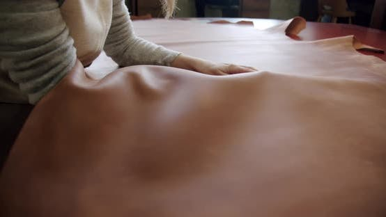 Thumbnail for Slow Motion Close Up Craftswoman Sleeking a Big Piece of Leather on the Table Slow Motion