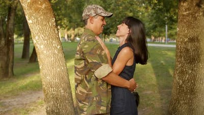 Happy Family Couple Meeting Outdoors After Military Mission