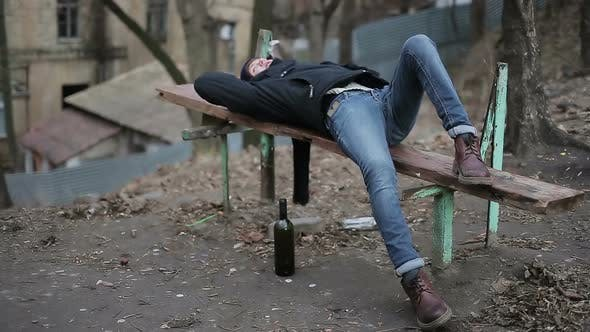 Thumbnail for Drunk Young Guy Lying on Bench