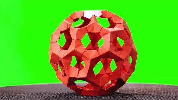 Red Modular Origami Ball on Green Screen.