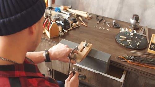 Hardworking Goldsmith Spending Time in Workshop