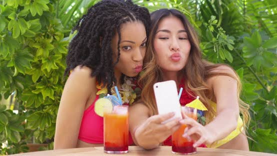 Thumbnail for Two best friends taking selfie while on tropical vacation
