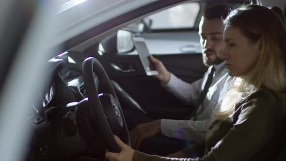 Thumbnail for Professional Salesman Selling Car to Female Client