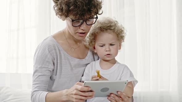 Mother and Toddler Boy with Tablet