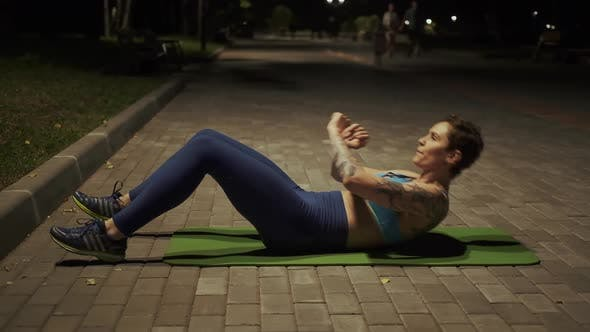 Thumbnail for Young Girl Doing Exercise on the Abdominal Muscles in the Evening Park