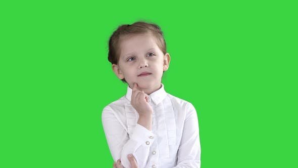 Cover Image for A Curious Little Girl Stands and Thinks on a Green Screen, Chroma Key