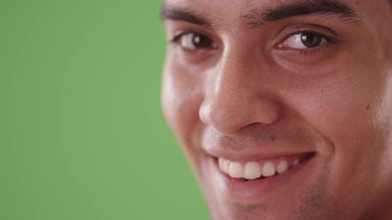 Close up portrait of Latino man looking at camera on green screen