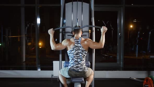 Thumbnail for Muscular Male Sportsman Working out Doing Exercise on Weight Lifting Training Machine in Gym