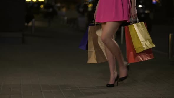 Thumbnail for Girl with Full Shopping Bags Looking at Shop Windows with Pleasure, Shopaholic