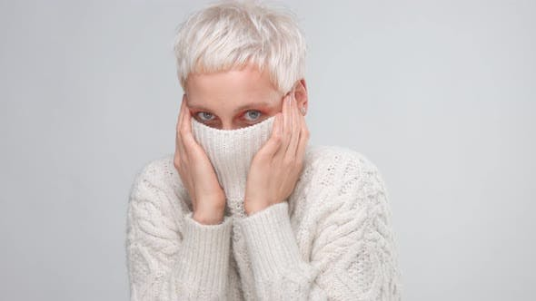 Blond Woman with Short Haircut Wears Knitted Sweater