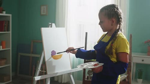 Little Artist Girl Practices Painting