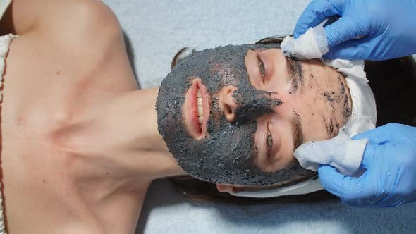 Thumbnail for Cosmetologist Using Cotton Pads for Wiping the Mask