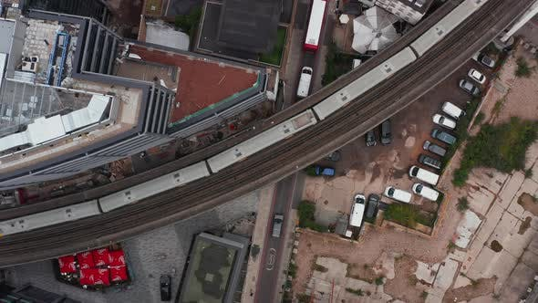 Aerial Birds Eye Overhead Top Down Ascending View of Turning Double Track Railway Line Leading