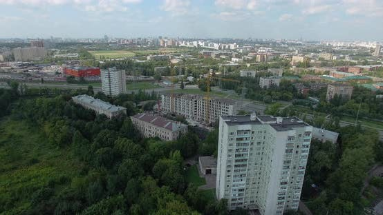 Thumbnail for An Aerial View of a Sunny Urbanscape Among Green Trees