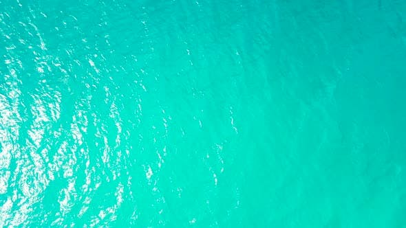 Beautiful drone clean view of a paradise sunny white sand beach and aqua blue ocean background