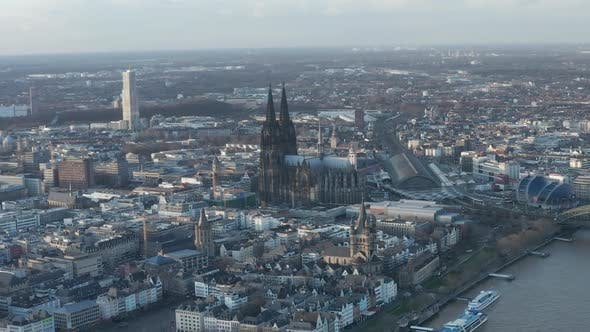 AERIAL: Wide Shot of Cologne Germany From the Air with Majestic Cathedral on Sunny Day