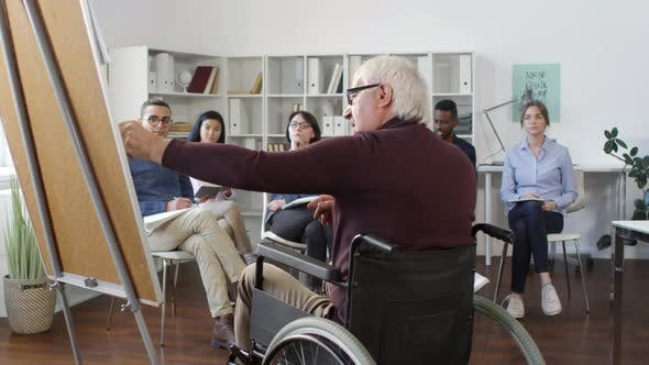 Cover Image for Multiethnic Students Listening to Disabled Teacher