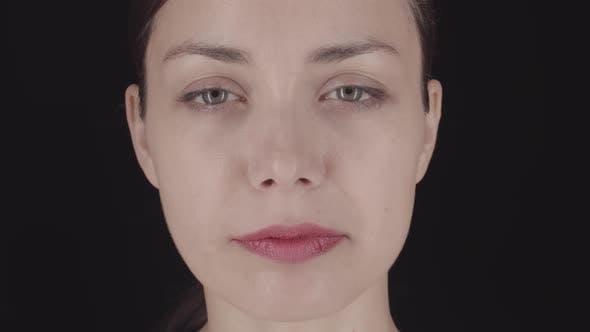 Thumbnail for Caucasian Female Face on Dark Background