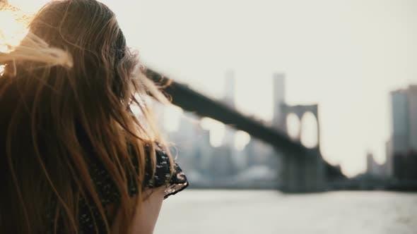 Thumbnail for Happy European Girl in Sunglasses Smiling, Enjoying Amazing River Sunset at Brooklyn Bridge New York