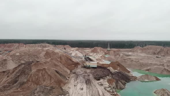 Thumbnail for Excavator is loading sand in quarry. Opencast quarry with excavator